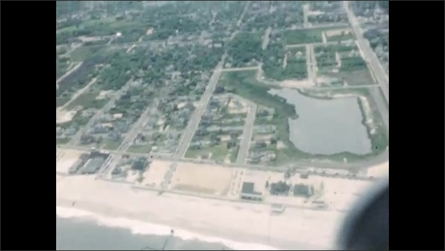 1940s: UNITED STATES: view from cabin. Boat on water from above. Small plane in flight. View across river
