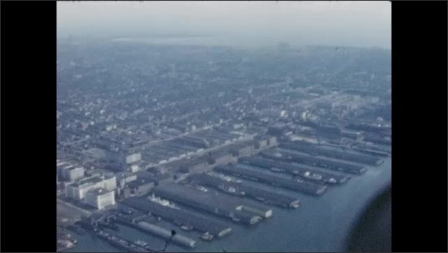 1940s: UNITED STATES: Coastline from above. Church viewed from above. Docks from above. Statue from above. Estuary and river meets sea