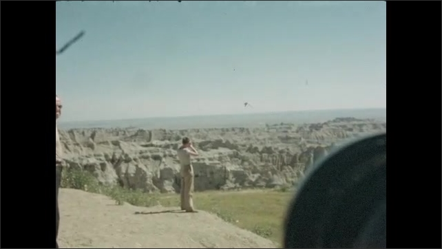 1940s: Car pulls off to side of road. Family views canyons. Boy looks through telescope.