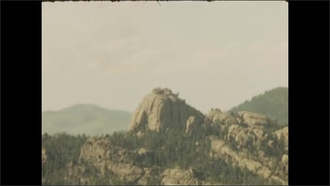 1940s: Mount Rushmore. Mountain and valley. Wooden sign.