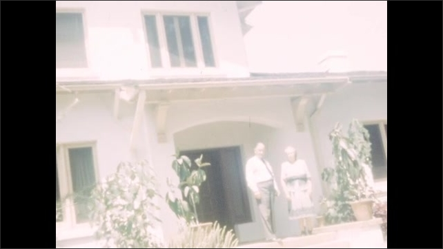 1940s: Orange grove. Worker stands on ladder, picks oranges off of tree. Man and woman in front of house. Boat drives on the ocean, plane flies by.