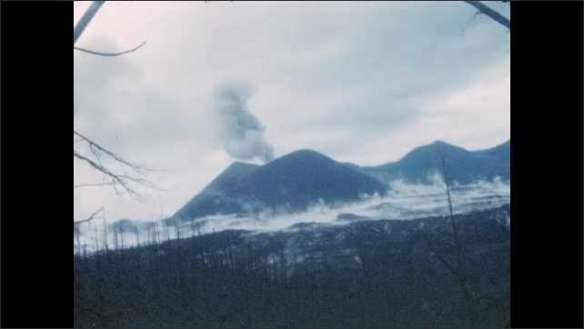 1940s: Shots of smoke rising from volcano. Shots of volcano.