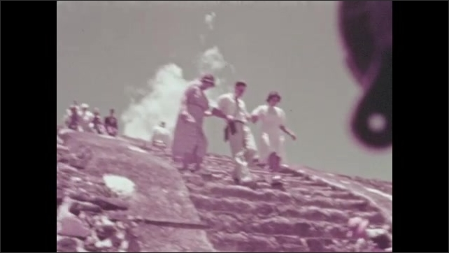 1930s: MEXICO: ladies climb down steps of ancient monument