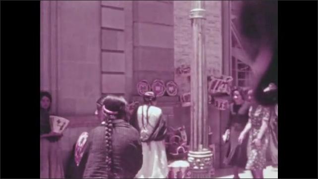 1930s: MEXICO: Toluca market. Ladies walk through Toluca market. Ladies sell wares.