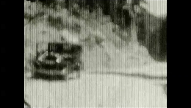 1920s: Girl gives water to doll. Car drives through tunnel carved into a rock. View from inside car that drives on dirt road. Woman and girl walk on a wooden dock over a river, building in background.