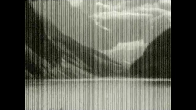 1920s: UNITED STATES: view of valley and mountains. River rapids in gorge. Bridge across rapids