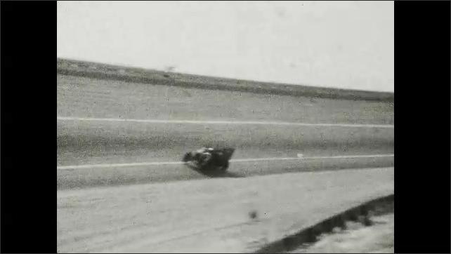 1920s: UNITED STATES: motor car on street. Motor car races. Cars race around steep sided track