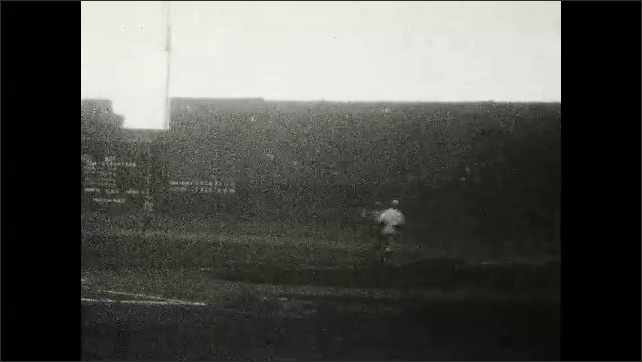 1920s: UNITED STATES: lady smiles at camera. Baseball match on pitch. Man runs in match. Crowd at match.