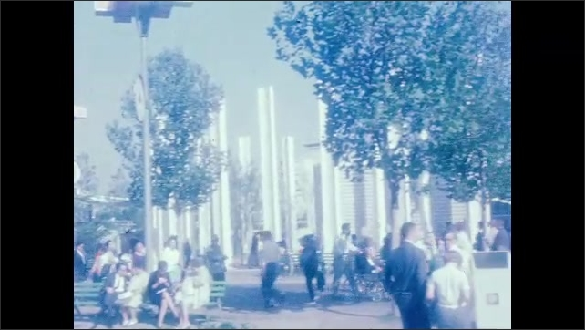 1960s: UNITED STATES: ladies stand by fountains. Visitors at World Fair