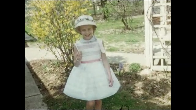 1960s: UNITED STATES: people leave church. Girl in white dress walks towards camera. Girl with missing teeth. Girl holds flower.