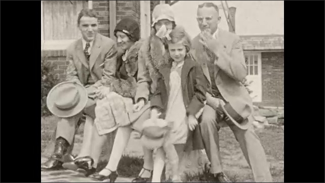 1930s: man sits down on bench with men, women and girl in front yard of house. girl stands up as family rests on seat. kids in coats and hats ride ponies guided by workers at amusement park.