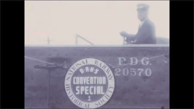 1930s: UNITED STATES: National Railway Historical Society. Convention Special. FDG 20570 train. Front of train. Man on train carriage. Steam around engine of train