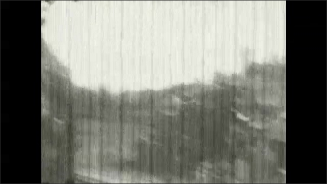 1920s: UNITED STATES: bridge across river. Train track on ground. View from train window