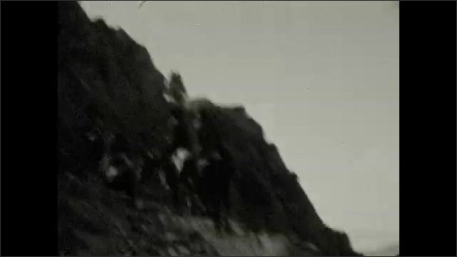 1920s: People ride horses along mountain path.
