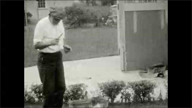 1920s: Children in playhouse.  Old man has dog do tricks.  Dog barks.
