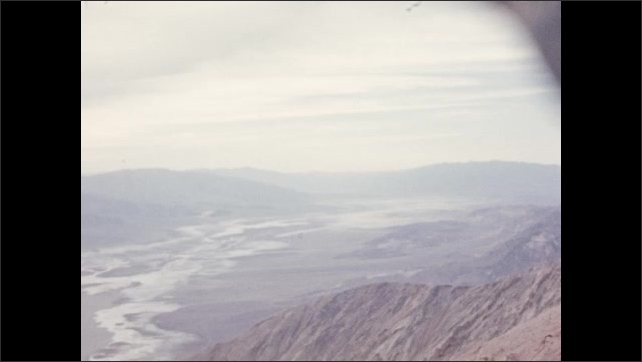 1940s: Death Valley, United States: mountain landscape in desert. River in valley. Clouds and sunset in desert.