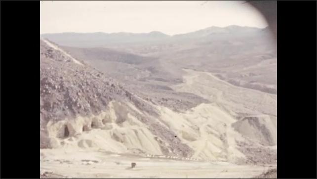 1940s: Death Valley, United States: lamp inside mine shaft. View across desert from mine cart. Tracks for mine cart