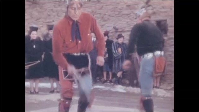 1940s: A man walks out of Hopi House and begins a Hoop Dance. Three Native American men perform a hoop dance as tourists watch. Dancers and performers leave the outdoor performance area.