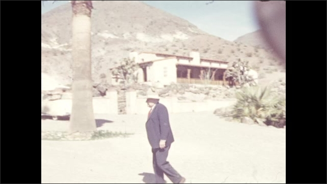1940s: DEATH VALLEY, UNITED STATES: house in valley. Man walks along path. Men outside building. People in caf??
