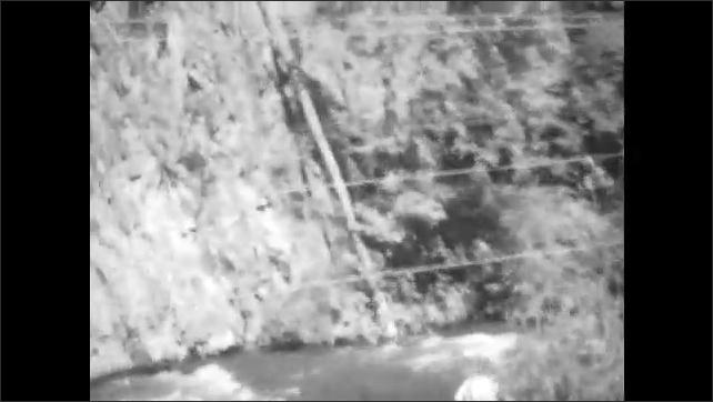 1920s: Travel through desert mountains by train. Man walks on train track. Man fishing in river.