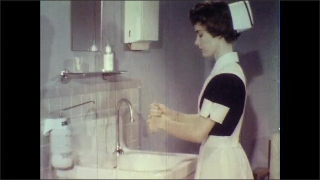 1960s: UNITED STATES: hands apply lotion from dispenser. Nurse covers hands in lotion.