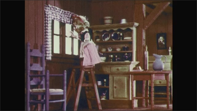1950s: Stop-motion animation.  Little girl stands on ladder and washes windows.  Boy sweeps floor.  Boy lifts edge of rug and sweeps dirt under.  Girl shakes her head and wags her finger.