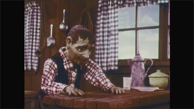 1950s: Stop-motion animation.  Man sits up in shock.  Little Boy.  Girl puts hand to mouth.  Man gestures and sits.  Girl cries and wipes eye.  Boy puts arm around girl.  Man puts head down on table.