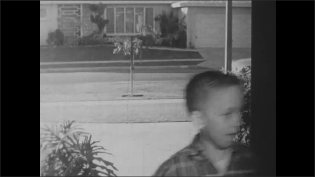 1950s: An ice cream man closes the freezer on his truck and children disperse. A boy passes a TV repairman as he returns home. He turns on the TV and the inner workings of the machine switch on.