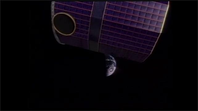 2000s: UNITED STATES: astronaut on space walk. Solar flare animation.