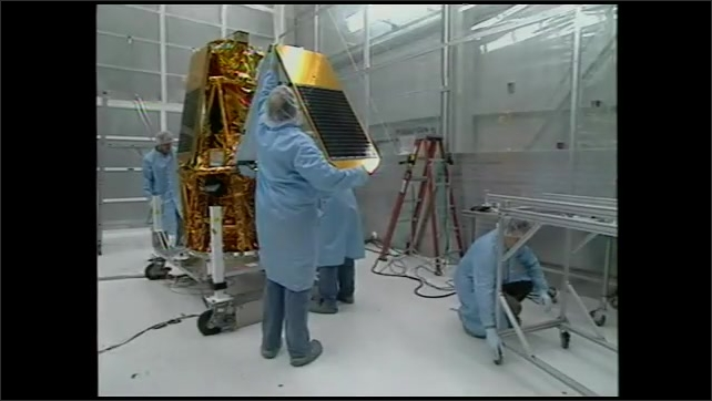 2000s: UNITED STATES: HESI animation. Astrophysicist and engineers work on HESI equipment in lab.