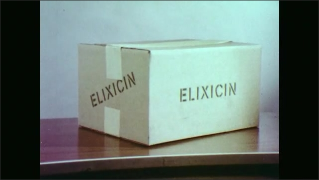 1970s: Kaleidoscope view of typed words on page of book. Books and signs on display for Food Will Kill You. Box of elixicin sits on table. Man at podium talking.