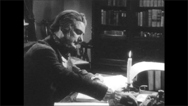 1940s: Various books by Henry Wadsworth Longfellow on table. Man holds book, sits down at desk, writes.