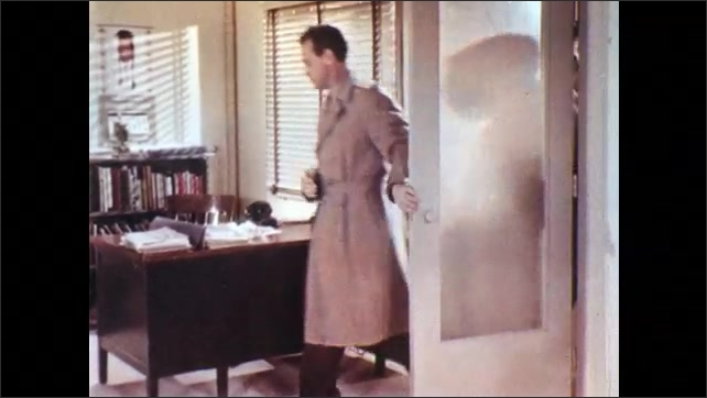 1950s: Man closes locker door. Men exit locker room. Men enter office and remove coats. Men sit at desk.