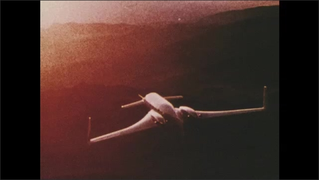 1970s: UNITED STATES: plane in sky. Plane flies over mountains. Starship one prototype. Engines on plane