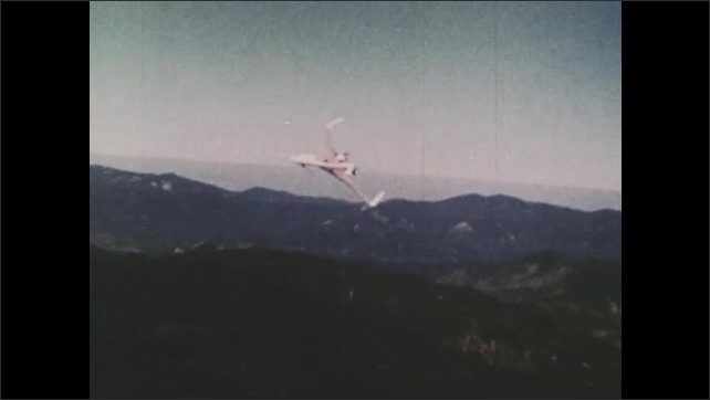 1970s: UNITED STATES: prototype plane in sky. Titanium fly. Propeller engine