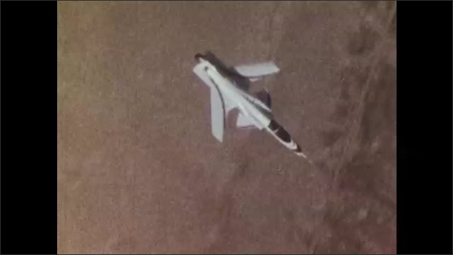 1970s: UNITED STATES: side profile of X29 plane in flight. Plane from above. Sunlight around plane
