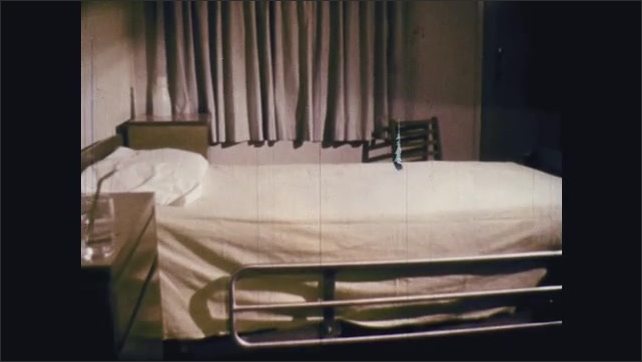 1960s: Man with bandaged face looks to the side. Empty bed in hospital room. Man with bandaged face lays in bed and looks sad. Woman nods head and talks.