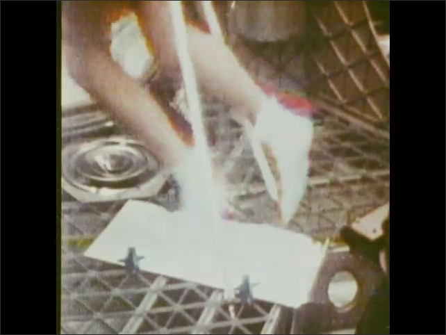 1970s: Man exercises on spacecraft treadmill device. Intertitle card.