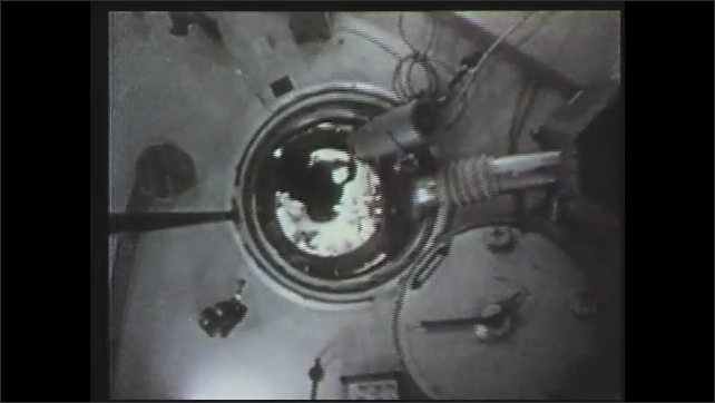 1970s: astronauts performing tests on bubbles, astronauts traveling around Skylab in zero-g