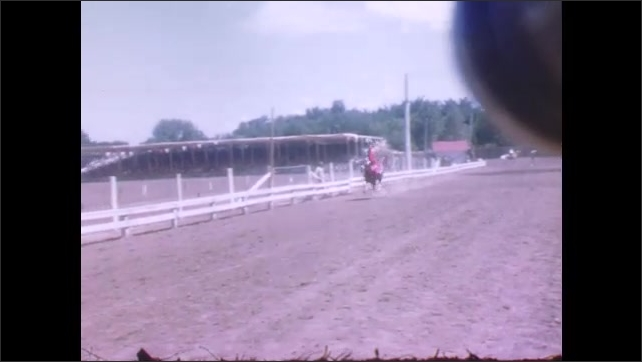 1940s: Cowgirls trick riding at the rodeo.