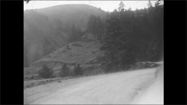 1930s: Dirt road through mountains.