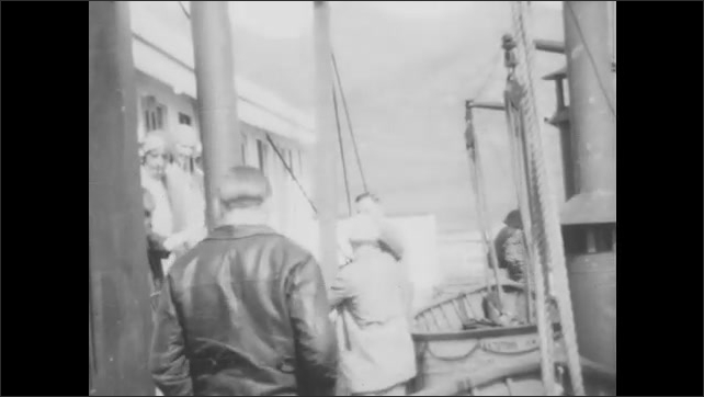 CANADA 1930s: Two girls run up the gang plank onto a ship. A man, woman, and girl pose in front of their cabin on the ship. People pose for the camera on deck.