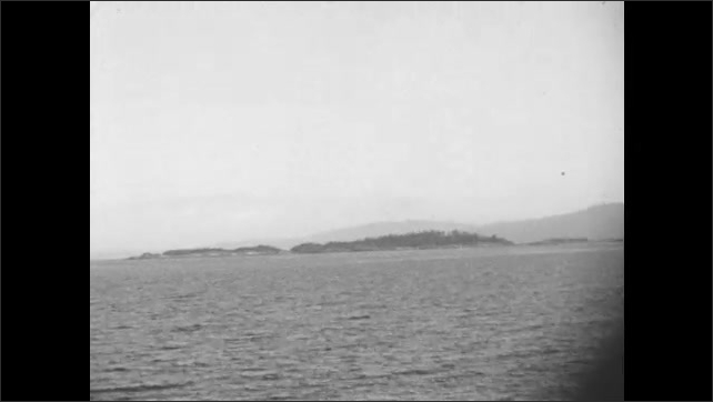 1930s: Views from ship, boat next to coastline. Views of water and coastline.