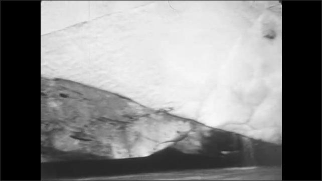 1930s: Close up of ice in glacier. Pan across glacier.