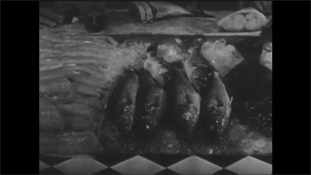 1940s: Pan across frozen fish.