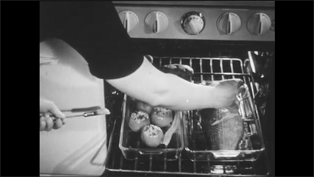 1940s: Woman bastes fish in oven, puts bacon on fish, closes oven.
