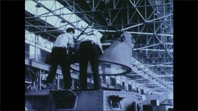 1940s: UNITED STATES: assembly on planes in factory. Chrysler plant produces tanks.