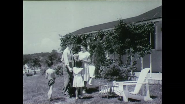1940s: UNITED STATES: man and children at home in new house. Chairs in garden. Couple and children in garden.
