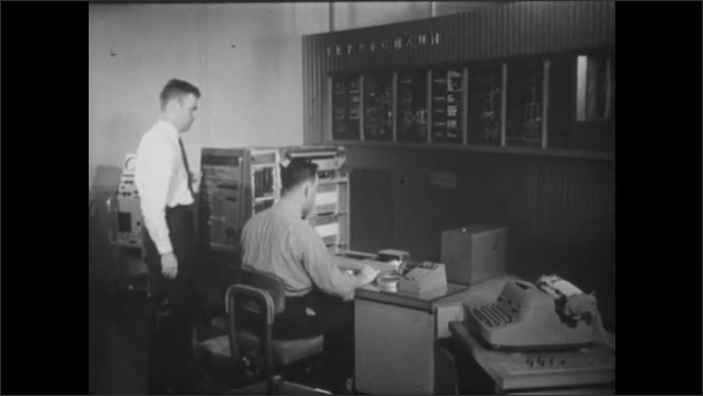 1950s: UNITED STATES: tubes and elements in machine. Transistorised computer with wires in laboratory. Man works in office