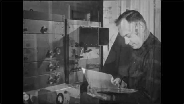 1950s: UNITED STATES: man works in signal room. Man thinks to self. Man writes notes in book. Workers in laboratory. Scientists study microwaves